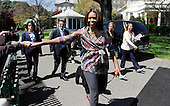 United States first lady Michelle Obama shakes hands with guests during the annual White House Easter Egg Roll on the South Lawn of the White House April 21, 2014 in Washington, DC. President Barack Obama and first lady Michelle Obama hosted thousands of people during the annual celebration of Easter.<br /> Credit: Olivier Douliery / Pool via CNP