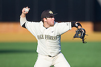 Wake Forest Demon Deacons third baseman Will Craig (22) makes a throw to first base against the Towson Tigers at Wake Forest Baseball Park on February 15, 2014 in Winston-Salem, North Carolina.  (Brian Westerholt/Four Seam Images)