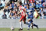 Getafe's Victor Sanchez against Almeria's Miguel Garcia Corona during La Liga Match. May 07, 2011. (ALTERPHOTOS/Alvaro Hernandez)
