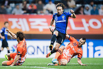 Gamba Osaka Midfielder Kurata Shu (C) fights for the ball with Jeju United Forward Marcelo Toscano (R) during the AFC Champions League 2017 Group H match Between Jeju United FC (KOR) vs Gamba Osaka (JPN) at the Jeju World Cup Stadium on 09 May 2017 in Jeju, South Korea. Photo by Marcio Rodrigo Machado / Power Sport Images
