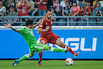 Diego Contento of Bayern Munich and Vasco Da Gama's Fagner of VfL Wolfsburg in action during a friendly match as part of the Audi Football Summit 2012 on July 26, 2012 at the Guangdong Olympic Sports Center in Guangzhou, China. Photo by Victor Fraile / The Power of Sport Images