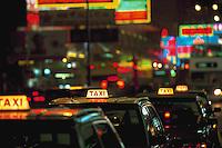 Taxis waiting for fares on Nathan Road, Hong Kong, China