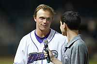 Alex Call (left) of the Winston-Salem Dash is interviewed by the voice of the Dash Joe Weil following his walk-off suicide squeeze bunt against the Salem Red Sox at BB&T Ballpark on April 21, 2018 in Winston-Salem, North Carolina.  The Dash walked-off the Red Sox 4-3.  (Brian Westerholt/Four Seam Images)