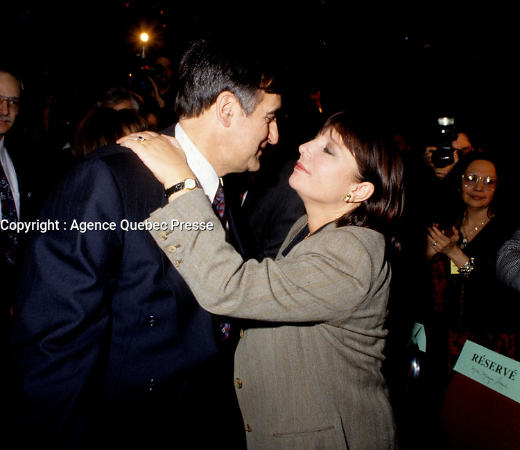 """Montreal (Qc) CANADA - File Photo - Jan 1996 -<br /> <br /> Lucien Bouchard,  Leader Parti Quebecois (from Jan 29, 1996 to March 2, 2001). seen in a file photo with Francine Simard<br /> <br /> After the Yes side lost the 1995 referendum, Parizeau resigned as Quebec premier. Bouchard resigned his seat in Parliament in 1996, and became the leader of the Parti Qu»b»cois and premier of Quebec.<br /> <br /> On the matter of sovereignty, while in office, he stated that no new referendum would be held, at least for the time being. A main concern of the Bouchard government, considered part of the necessary conditions gagnantes (""""winning conditions"""" for the feasibility of a new referendum on sovereignty), was economic recovery through the achievement of """"zero deficit"""". Long-term Keynesian policies resulting from the """"Quebec model"""", developed by both PQ governments in the past and the previous Liberal government had left a substantial deficit in the provincial budget.<br /> <br /> Bouchard retired from politics in 2001, and was replaced as Quebec premier by Bernard Landry."""