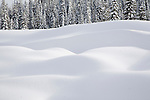 Deep snow drifts in the mountains of western Montana in the Lolo National Forest