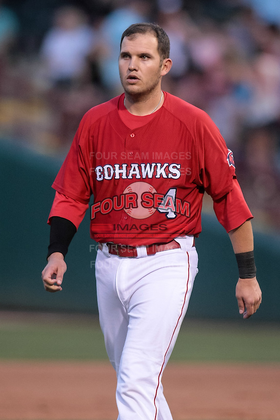 Brandon Laird (4) of the Oklahoma City RedHawks heads toward the dugout during the Pacific Coast League game against the Round Rock Express at Chickashaw Bricktown Ballpark on June 14, 2013 in Oklahoma City ,Oklahoma.  (William Purnell/Four Seam Images)
