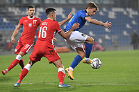 Arkadiusz Reca of Poland and Nicolo Barella of Italy compete for the ball during the Uefa Nation League Group Stage A1 football match between Italy and Poland at Citta del Tricolore Stadium in Reggio Emilia (Italy), November, 15, 2020. Photo Andrea Staccioli / Insidefoto