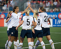 Shannon Boxx high fives Abby Wambach. The US Women's National Team defeated the Canadian Women's National Team, 4-0, at BMO Field in Toronto during an international friendly soccer match on May 25, 2009.