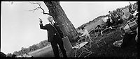 """Richard Buckminster """"Bucky"""" Fuller lecturing outside under a tree,  Southern Illinois University, Carbondale 1971. 35mm panoramic photographs by Larence N. Shustak."""
