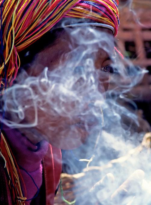 Hill tribe,Smoking the traditional Cigars Myanmar, Burma,