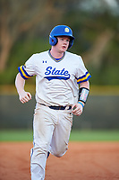 South Dakota State Jackrabbits catcher Ryan McDonald (8) rounds the bases on a Landon Badger (not shown) home run during a game against the Northeastern Huskies on February 23, 2019 at North Charlotte Regional Park in Port Charlotte, Florida.  Northeastern defeated South Dakota State 12-9.  (Mike Janes/Four Seam Images)