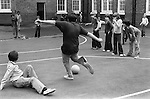 Primary school playground. Boys playing football. South London. 1970s Britain...