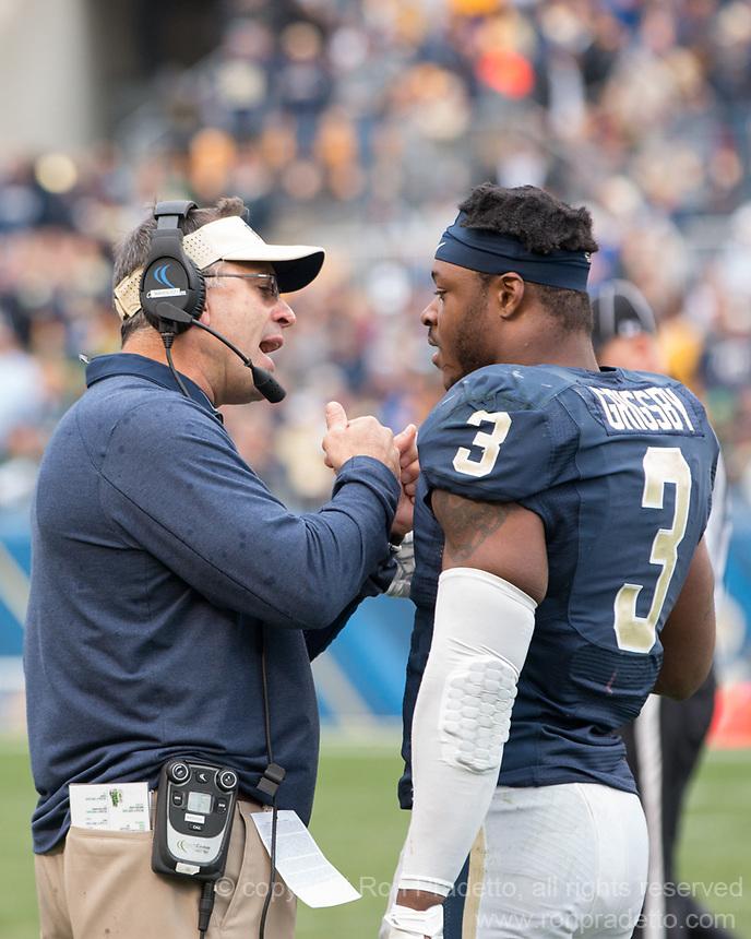 Pitt head coach Pat Narduzzi (left) instructs Pitt linebacker Nicholas Grigsby. The Notre Dame Fighting Irish football team defeated the Pitt Panthers 42-30 on Saturday, November 7, 2015 at Heinz Field, Pittsburgh, Pennsylvania.