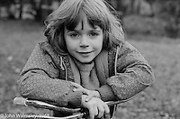Young girl on her bike, Summerhill school, Leiston, Suffolk, UK. 1968.