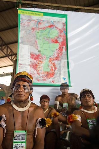 """Altamira, Brazil. """"Xingu Vivo Para Sempre"""" protest meeting about the proposed Belo Monte hydroeletric dam and other dams on the Xingu river and its tributaries. Kalapalo indians infront of a map of the Xingu area."""