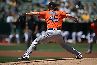 OAKLAND, CA - JUNE 2:  Gerrit Cole #45 of the Houston Astros pitches against the Oakland Athletics during the game at the Oakland Coliseum on Sunday, June 2, 2019 in Oakland, California. (Photo by Brad Mangin)