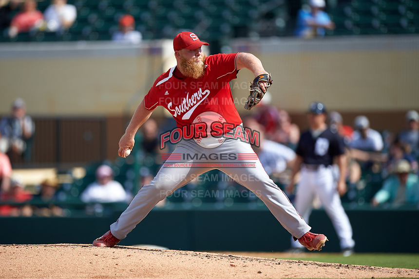 Florida Southern Moccasins relief pitcher Walker Burgess (19) delivers a pitch during an exhibition game against the Detroit Tigers on February 29, 2016 at Joker Marchant Stadium in Lakeland, Florida.  Detroit defeated Florida Southern 7-2.  (Mike Janes/Four Seam Images)