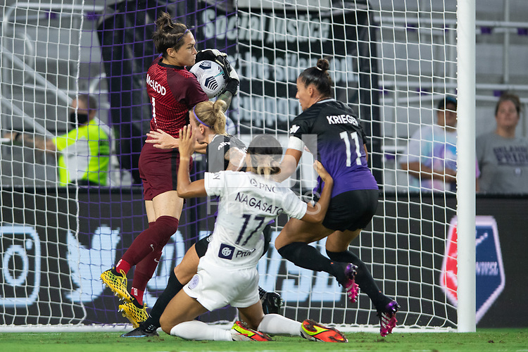 ORLANDO, FL - SEPTEMBER 11: Erin McLeod #1 of the Orlando Pride makes a save during a game between Racing Louisville FC and Orlando Pride at Exploria Stadium on September 11, 2021 in Orlando, Florida.