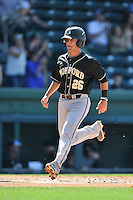 Third baseman Max McDougall (26) of the Wofford Terriers scores a run in a SoCon Tournament game against Western Carolina on Wednesday, May 25, 2016, at Fluor Field at the West End in Greenville, South Carolina. Western won, 10-9. (Tom Priddy/Four Seam Images)