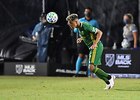 LAKE BUENA VISTA, FL - JULY 18: Andy Polo #7 of the Portland Timbers heads the ball during a game between Houston Dynamo and Portland Timbers at ESPN Wide World of Sports on July 18, 2020 in Lake Buena Vista, Florida.