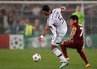 Calcio, Champions League, Gruppo E: Roma vs Bayern Monaco. Roma, stadio Olimpico, 21 ottobre 2014.<br /> Bayern's Mehdi Benatia is challenged by Roma's Juan Iturbe, right, during the Group E Champions League football match between AS Roma and Bayern at Rome's Olympic stadium, 21 October 2014.<br /> UPDATE IMAGES PRESS/Isabella Bonotto