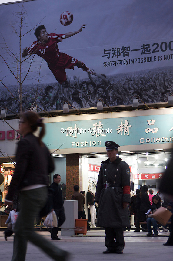 Big advertising billboard of Adidas, one of the Beijing  Olympic sponsors, is seen in Wangfujing commercial district, Beijing, China..