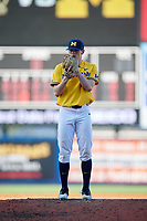 Michigan Wolverines relief pitcher Benjamin Keizer (14) gets ready to deliver a pitch during a game against Army West Point on February 17, 2018 at Tradition Field in St. Lucie, Florida.  Army defeated Michigan 4-3.  (Mike Janes/Four Seam Images)