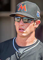 7 March 2016: Miami Marlins infielder J.T. Riddle looks out from the dugout prior to a Spring Training pre-season game against the Washington Nationals at Space Coast Stadium in Viera, Florida. The Nationals defeated the Marlins 7-4 in Grapefruit League play. Mandatory Credit: Ed Wolfstein Photo *** RAW (NEF) Image File Available ***