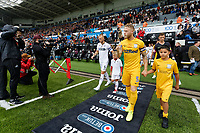( L-R ) Mike van der Hoorn of Swansea City and Tom Clarke of Preston North End lead their team out of the tunnel during the Sky Bet Championship match between Swansea City and Preston North End at the Liberty Stadium, Swansea, Wales, UK. Saturday 11 August 2018