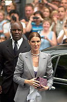 Singer Celine Dion arrive with her bodyguard (behind) for her son Rene Charles baptism, July 25th 2001 at the Notre Dame Basilica in Montreal, CANADA.