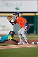 St. Lucie Mets first baseman Jeremy Vasquez (16) waits for a throw as Lucas Tancas (27) dives back to the bag during a Florida State League game against the Bradenton Barbanegras on July 27, 2019 at LECOM Park in Bradenton, Florida.  Bradenton defeated St. Lucie 3-2.  (Mike Janes/Four Seam Images)