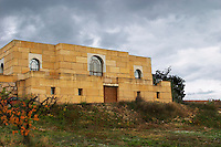 The imposing winery building built from gigantic stone blocks of cathedral dimensions, under storm clouds. Domaine Viret, Saint Maurice sur Eygues, Drôme Drome France, Europe
