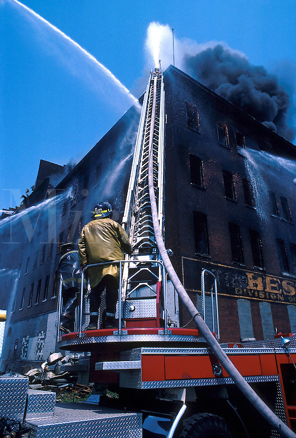 Firefighters putting out fire in an industrial building, smoke, firefighter,15-3000, 08-3500. Buffalo New York United States.