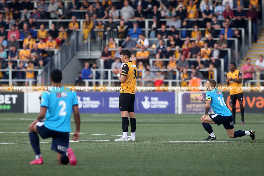 Eastbourne Borough players take a knee ahead of kick-off while Maidstone players opt to stand during Maidstone United vs Eastbourne Borough, Vanarama National League South Football at the Gallagher Stadium on 9th October 2021