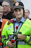 (Oslo July 25, 2011) A police woman with flowers given to her by members of the public. An estimated 150,000 people gathered in Oslo town centre for a vigil following Friday's twin extremist attacks ...A large vehicle bomb was detonated near the offices of Norwegian Prime Minister Jens Stoltenberg on 22 July 2011. .Another terrorist attack took place shortly afterwards, where a man killed 68 people, mainly children and youths attending a political camp at Utøya island. ..Anders Behring Breivik was arrested on the island and has admitted to carrying out both attacks..(photo:Fredrik Naumann/Felix Features)