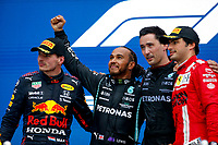 26th September 2021; Sochi, Russia; F1 Grand Prix of Russia, Race Day:  44 Lewis Hamilton GBR, Mercedes-AMG Petronas F1 Team on the podium as winner of the grand prix with 2nd placed  33 Max Verstappen NED, Red Bull Racingand 3rd placed  Carlos Sainz ESP, Scuderia Ferrari Mission Winnow