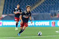 FOXBOROUGH, MA - JULY 9: Noel Buck #61 of New Englans Revolution II brings the ball forward during a game between Toronto FC II and New England Revolution II at Gillette Stadium on July 9, 2021 in Foxborough, Massachusetts.