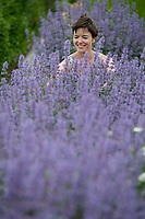BNPS.co.uk (01202) 558833<br /> Pic: ZacharyCulpin/BNPS<br /> <br /> Swapping Flour for Flowers....<br /> <br /> Pictured: Purple patch, Helen among the purple catmint plants<br /> <br /> Helen Stickland runs her Black Shed Flower farm from 2 empty grain stores. <br /> <br /> The grain stores sits on a 2 acre site, where Helen and her husband Paul Stickland grow 500 different varieties of flowers in Sherborne, Dorset<br /> <br /> Helen and Paul are members of Flowers from the Farm, the British cut flower growers' association, which has seen membership leap by 75% in the past 2 years.