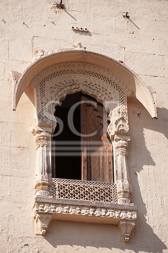 Jodhpur, India. Mehrangarh sandstone hill fort of the Marwar rulers. White carved window.