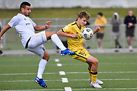 Benjamin Old of the Wellington Phoenix competes for the ball with Mario Barcia of Team Wellington during the ISPS Handa Men's Premiership - Wellington Phoenix v Team Wellington at Fraser Park, Wellington on Saturday 14 November 2020.<br /> Copyright photo: Masanori Udagawa /  www.photosport.nz