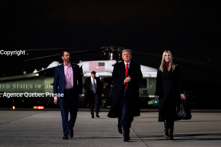 President Trump Travels to Georgia<br /> <br /> President Donald J. Trump walks with Presidential Advisor Ivanka Trump and his son Donald J. Trump Jr. to board Air Force One at Dobbins Air Reserve Base in Marietta, Ga. Tuesday, Jan. 4, 2021, for their return flight to Joint Base Andrews, Md. (Official White House Photo by Tia Dufour)