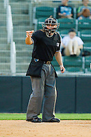 Home plate umpire Jorge Teran makes a strike call during the South Atlantic League game between the Hagerstown Suns and the Kannapolis Intimidators at CMC-Northeast Stadium on May 17, 2013 in Kannapolis, North Carolina.  The Suns defeated the Intimidators 9-7.   (Brian Westerholt/Four Seam Images)