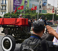 outside the grave site of late president Beji Caid Essebsi as mourners await outside, at Jellaz Cemetery in the capital Tunis on July 27, 2019. Essebsi, the country's first head of state elected in nationwide polls, died on July 25 at the age of 92, triggering fears of political unrest in a country seen as a rare success story following the Arab Spring uprisings. <br /> <br /> PHOTO :  Wassim Jdidi/AQP