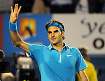 January 29, 2010.Roger Federer, of Switzerland, waves to fans after defeating Jo-Wilfried Tsonga, of France, in the semi-final of the Australian Open, Melbourne Park, Melbourne, Australia