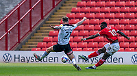 24th April 2021, Oakwell Stadium, Barnsley, Yorkshire, England; English Football League Championship Football, Barnsley FC versus Rotherham United; Daryl Dike of Barnsley shoots past Angus MacDonald of Rotherham but sees his shot go wide