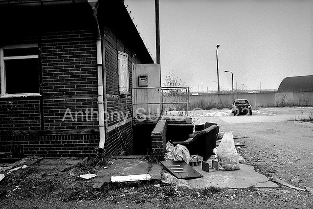 Leuna, Germany  .1998.Residential homes around the massive chemical factory of Leuna lay in ruins. Part of the housing in the area has been repaired others have gone completely derelict. Unemployment in these districts is high- 20% or more..