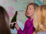"""Deborah Green speaks with guests about sparkling wine during the Reno Magazine """"Bubbles Tasting"""" event at Total Wine in Reno on Friday night, February 9, 2018."""
