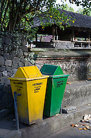 Bali, Indonesia.  Trash Bins, Labeled for Recycling Plastic and Organic Waste.  Tenganan Village.