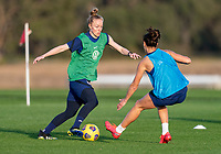 ORLANDO, FL - JANUARY 21: Becky Sauerbrunn #4 dribbles past Carli Lloyd #10 of the USWNT during a training session at the practice fields on January 21, 2021 in Orlando, Florida.