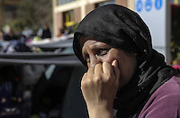 Pictured: A migrant woman shows signs of desperation Thursday 03 March 2016<br /> Re: Migrants have been gathering at the port of Piraeus, near Athens, Greece